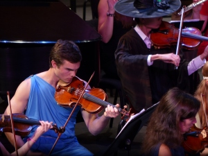 A soloist performs at the Halloween concert