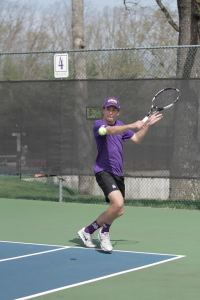 A student plays tennis