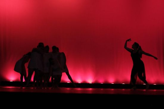 Students dancing in the performance