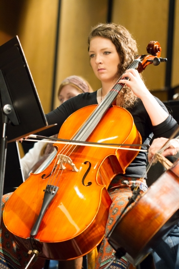 A cellist in the Sewanee orchestra during the Halloween concert